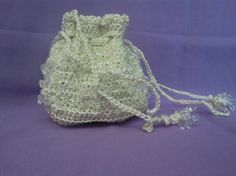 A small sized handy battwa made up of pure white thread and crystal beads which makes it look sober and elegant.