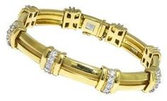 Tiffany  Co. This is a beautiful 18k yellow gold platinum bracelet from the 1995 This is a beautiful Tiffany  Co. The bracelet features sparkling round cut diamonds that weigh approximately 2.00ct; and set on platinum bezels. The color of these diamonds is F with VS1 clarity. The measurement of the bracelet is 10mm in width, 7 inches in length and weighs 47.6 grams.