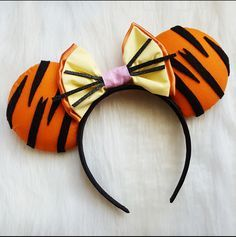 Tigger from Winnie the Pooh Inspired ears! Keep in mind, all ears will differ slightly. Turnaround for all ears is 7-10 days plus shipping 2-5 days. Unless told otherwise. Plan ahead (: I only ship within the United States as of right now.
