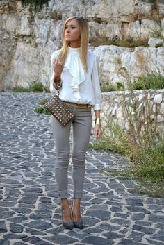 Spring business casual with grey pants, grey heels, and a white collared ruffel shirt.