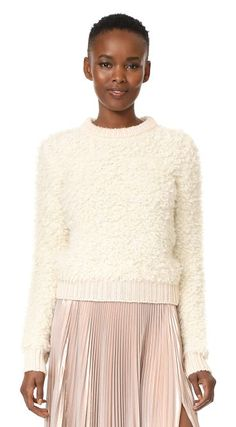 long sleeve pullover by Carven. Soft, brushed loops lend rich texture to this cozy bouclé Carven sweater. Silky, ribbed edges. Long sleeves. Fabric: ...