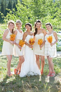 I don't like the idea of bridesmaids wearing white, but I love the bouquets