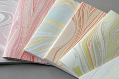 marbled softcover booklets by Natalie Stopka