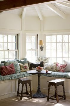 A plush and cozy window seat basks in the light of Ruthie Sommers's California ranch.
