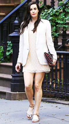 Liv Tyler made it a point to emphasize her off-white lace mini with a crisp optic white blazer. A burgundy clutch and metallic flat sandals acted as her accessories.