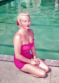 Lana Turner lounging by the pool at the Coral Casino in Santa Barbara, California, 1951.