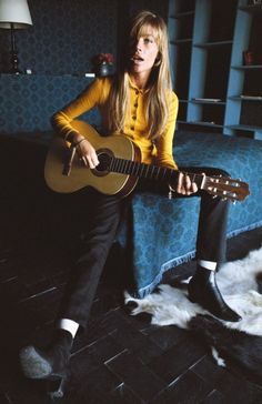 Francoise Hardy in skinny pants, sweater, and chelsea boots