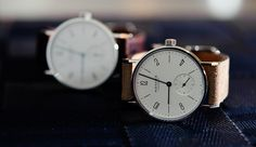Nomos.   http://www.nomos-store.com/en/Watches/Tangente/Smaller-watches-with-manual-winding/Tangente-33-stainless-steel-back.html