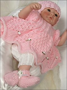 "A pretty smock-style gathered top with leggings. The outfit is completed with a bandanna and Mary Jane-style shoes. Size: Includes three options: 16""-18"" doll or preemie baby, made with fine (sport) weight yarn and sizes 2 (2.75mm) and 3 (3.25mm) needles; 19""-20"" doll or newborn, made with light (DK) weight yarn and sizes 3mm (or U.S. size 3, 3.25mm) and 5 (3.75mm) needles; and 21""-22"" doll or 0-3 months, made with light (DK) weight yarn and sizes 3mm (or U.S. size 3, 3.25mm) and 6 (4mm)…"