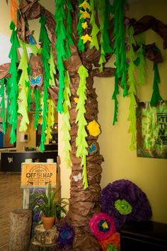 Lifeway Journey off the Map VBS Decorations (Photo Credit: Full of Grace Photography) Butcher paper tree, tablecloth vines, Dollar tree flowers on string, giant tissue paper flowers