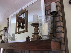 Winter mantel idea with pinecones