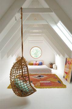 hanging wicker chair in attic bedroom