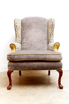 I like the idea of  mixing fabrics on this velvet, wingback chair... from etsy