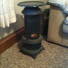 Kerosene lamp end table with lazy Susan top attached.  LED candle inside makes it look lit up.  Haha