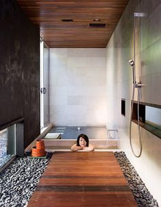 Japanese Bathroom Design... I really like the stones and wood on the floor.
