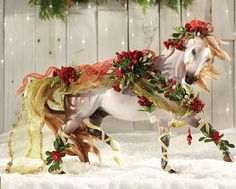 Breyer Bayberry & Roses 2014 Holiday Horse - Reminiscent of the beauty found in a snowy landscape at twilight and wrapped in the festive colors of holiday flora.
