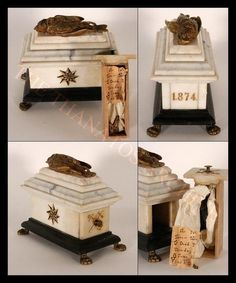 A Victorian Era bird sarcophagus, made of brass and marbleInside is a shrouded bluebird with this note:Our pet Wee-WeeDied Monday 18 June, 1874at 7:55o'clock.