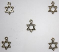 5 Small Jewish stars. Great for a bracelet. Lot of 5 for each order. So if you want 10 small stars - then order 2 (two) as quantity. Not plastic. See photos for approximate size.