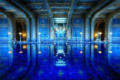 THE ROMAN POOL AT HEARST CASTLE Photograph by Trey Ratcliff @ stuckincustoms.com The Roman Pool at Hearst castle is a tiled indoor pool decorated with eight statues of Roman gods, goddesses and heroes. The pool appears to be styled after an ancient Roman bath such as the Baths of Caracalla in Rome…