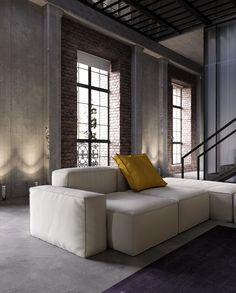 Smart furniture adds a stylish and refined edge. Modular seating is a great choice for a home as spacious as this one - this handsome sofa is from the Peanut B series by Mauro Lipparini. All of the liners are completely removable so even the fabric colors are modular. Neat, right?