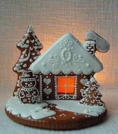 Wonderful! What I like about this is that it is different. It looks like it is simply cookies glued to a round disk base. What an easier method for making a gingerbread house. And the window tops it off in stellar fashion. I just love it.