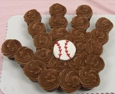 Baseball glove made out of chocolate cupcakes for a baseball baby shower @Erin B Rubenstein I think you were pining baseball stuff the other day...this is cute!