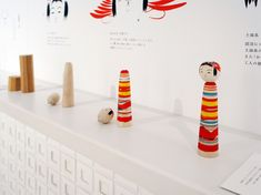 japanese kokeishi dolls are wooden sculptures of the human figure in its most basic, stripped down form - a three-dimensional stick figure, the bare minimum for an object to read as human-like.