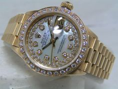 Rolex Ladies Presidential Oyster in 18k gold with diamond bezel.  She is beautiful <3