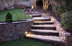 If you are considering lighting your garden/landscape, do remember firstly that a little light goes a long way at night. See our top garden lighting tips and ideas below to help you light beautifully and use the right exterior light . Garden Stairs, Terrace Garden, Garden Paths, Garden Stream, Patio Stairs, Garden Retaining Walls, Sleeper Retaining Wall, Stone Retaining Wall, Brick Garden