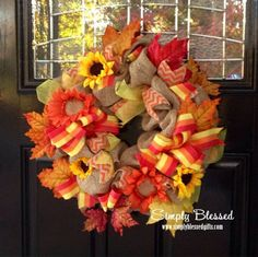 Orange, Yellow, and Red Ribbons and Burlap Wreath with yellow and orange sunflowers and leaves - 16 inches- Front door, dorm, or accent - Chevron - This wreath combines 2 favorite trends....burlap and chevron! The wreath is the perfect size for your front door or to use as an accent in your