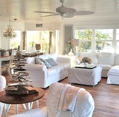 White Beach Cottage Living Room... with Driftwood Christmas Tree: http://beachblissliving.com/white-vintage-beach-cottage/