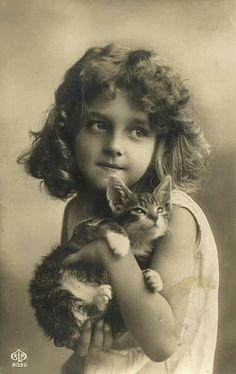 Vintage photo. Little girl & her cat.