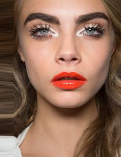 Vinyl Lip Hit Another insight into what we'll be wearing this summer. Moschino sent Cara down the catwalk in full on eye watering gloss. We love this high maintenance look, but advise wearing this much gloss with a hair up approach. Winter will throw wind into the equation and hair-stuck-in-gloss goes some way to negating the mood boosting effect we were going for.