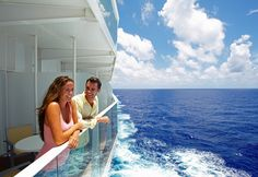 A young couple lean over their private #balcony onboard a Royal Caribbean International cruise ship. The ship's wake in the background is slowly trailing off into the distance #cruise #holiday Find out more at http://www.the-cruise-specialists.co.uk/cruise-lines/royal-caribbean-international