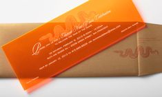 Paired with a metallic gold envelope, this neon orange acrylic invitation with white details is a bold way to invite friends to celebrate the Chinese new year. This concept works well for other party themes as well.