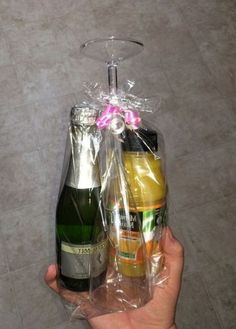Mini Mimosa Kit I made as a graduation gift for my dental hygiene students. So fun and easy! 1 mini Barefoot Brut Cruvee Champagne, 1 mini orange juice, 1 plastic champagne glass from the Dollar Tree and a plastic gift bag from the Dollar Tree. Homemade Christmas, Diy Christmas Gifts, Simple Christmas, Holiday Gifts, Coworker Christmas Gifts, Craft Gifts, Diy Gifts, Dental Hygiene Student, Alcohol Gifts