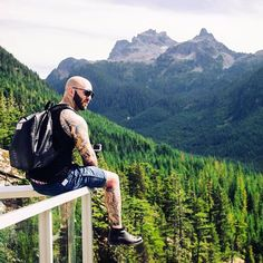 One of our amazing customers chilling in Vancouver with his Black Ostrich @highspiritbag . Such an Epic pic! www.highspiritbags.com :-) #highspirit #highspiritbag #bag #backpack #vancouver #canada #dope #mountains #canada #trees #nature #travel #seetheworld #tourist #tourism #worldwide #seatoskygondola #tattoos #stylish #style #unique #new #sky #sunglasses #ostrichbag #natural #travelblog #ootd #scenery