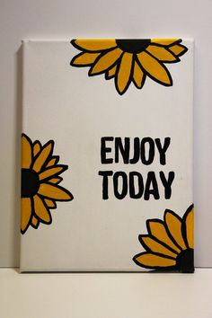 """White canvas with yellow and black sunflowers with an espresso center, along with the words, """"ENJOY TODAY"""" in black acrylic. Sunflower Canvas Paintings, Canvas Painting Quotes, Small Canvas Paintings, Cute Paintings, Diy Painting, Quote Canvas, Kids Canvas Art, Small Canvas Art, Doodle Canvas"""