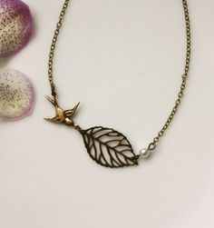 An Antiqued Brass Leaf. Single Ivory Pearl, Flying Swallow Bird Necklace. Bridesmaid Gifts. Maid Of Honor. Bridesmaid Necklaces. For Sis.
