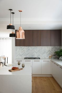 Reno Rumble 2016 James and Hayley's Kitchen. Marble Herringbone Tiles paired with Dark Wood cabinetry and Metallic pendant lights.