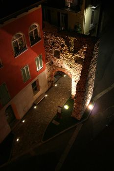 "Restoration of the town gate ""Porta Romana"", lighting uplighters by Arcluce"