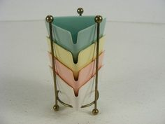 vintage colored plastic ashtrays with brass holder