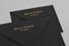 Black envelopes with gold block foil detail for London based French Patisserie Belle Epoque by Mind Design