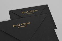 Black envelopes with gold block foil detail for London based French Patisserie Belle Epoque by Mind Design