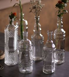 ornate glass bottles as vases