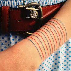 paper lines tattoo