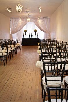 wedding, wedding ceremony, ceremony, aisle, black bows, white paper flowers, black chairs