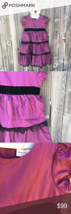 "{Hanna Andersson} Fuschia Iridescent Dress 10 Like new!! Beautiful fuchsia (pink/purple) taffeta style (but much smoother, softer and not stiff) fabric dress with black velvet elastic empire waist and black tulle tiered ruffle skirt. Perfect for dancing and twirling at those Spring weddings! Excellent as a flower girls and junior bridesmaid dress. Hanna Andersson's website says Size 130 is a Girls Size 8/10 in US. 15"" pit to pit, 14"" waist, 33"" shoulder to hem lengths, 4.75"" puffy cap…"