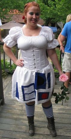 This confuses me but is nonetheless awesome: R2D2 renaissance fair dress