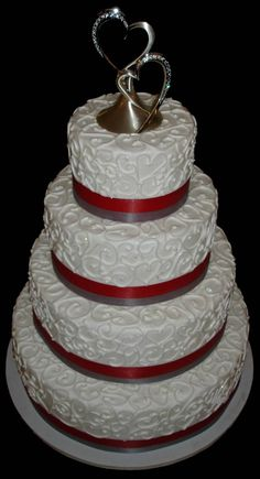 buttercream wedding cake photos | beautiful buttercream wedding cake with swirl design and scarlet and ...
